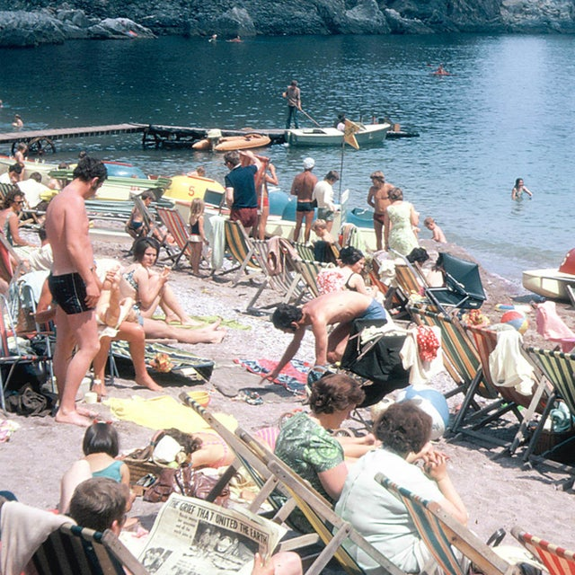 A photograph from a bygone era, this toy camera film slide captures Ansley's Cove on the southern coast of England. If...