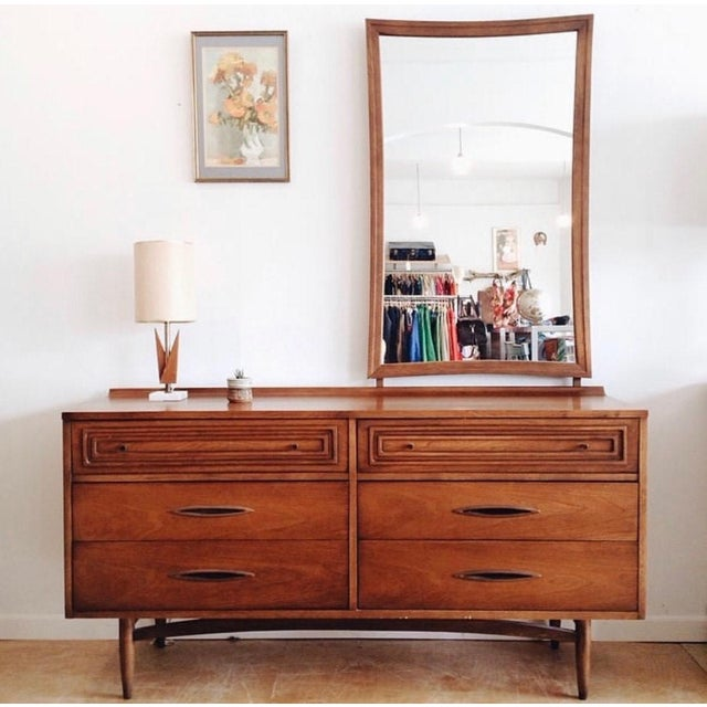 Offered is a walnut dresser/credenza made by Broyhill Premier's 'Sculptra'. Has 6 dovetailed drawers - two atop with...