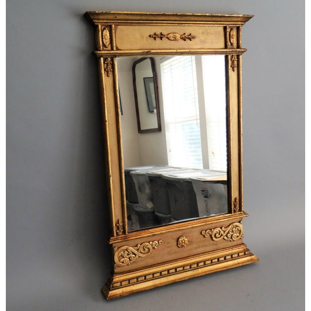 Mid 20th-Century Italian giltwood and gesso mirror. It is in a Neoclassical style with applied decoration and a stepped...