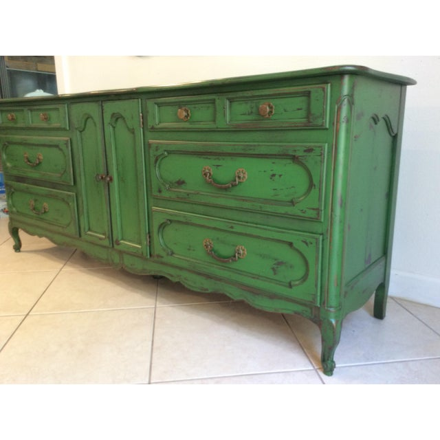 Handsome and sturdy mid-20th-century provencal style credenza, professionally refinished in a deep forest green and...