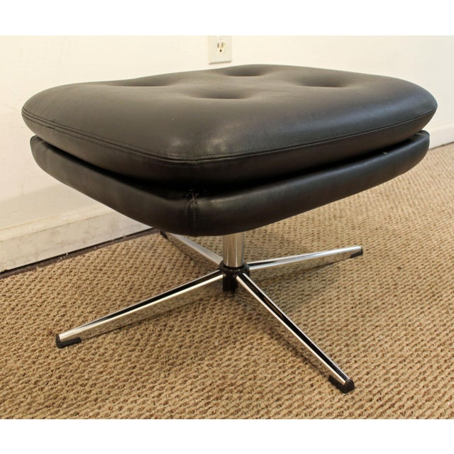 Offered is a Mid-Century Danish Modern Black Chrome Swivel Overman Ottoman/Foot Stool. The piece is an original signed...