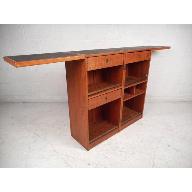 Stunning Danish dry bar designed by Reno Wahl Iversen, made in Denmark, circa 1960s. Great design featuring felt-lined...