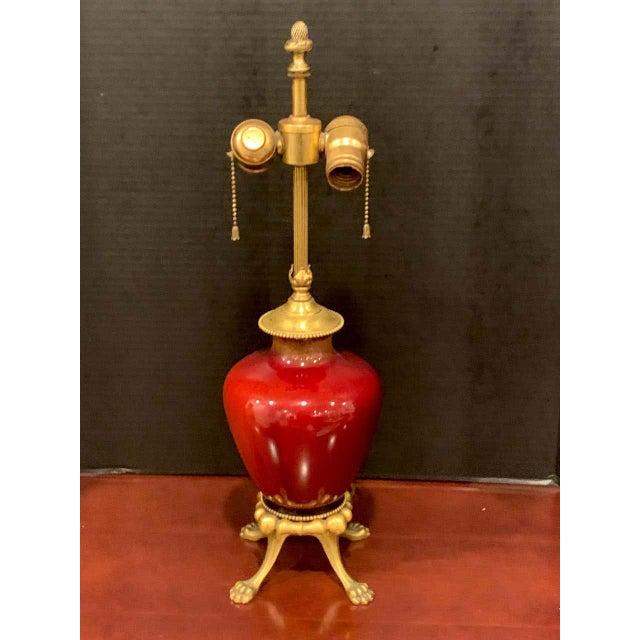 Sang de Boeuf, Ormolu Mounted Vase,by Rookwood Pottery, 1936, now as a Lamp, Light Glaze Beautiful glazed vase raised on...