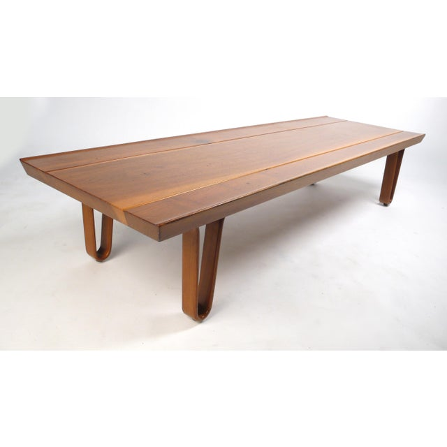Long-John Bench designed by Edward Wormley for Dunbar. Solid walnut top with wood hairpin legs.