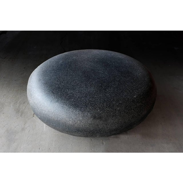 The Pebble table is an elegant cocktail table with an organic form. Pictured in our Coal Stone finish, the texture and...