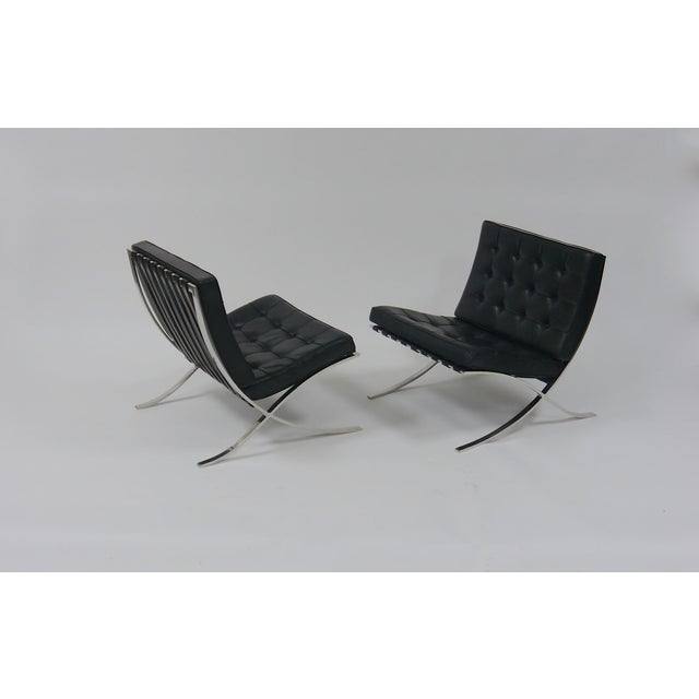 Pair of Barcelona Chairs by Mies Van Der Rohe for Knoll. Stainless Steel and Black Leather, Circa 1975.