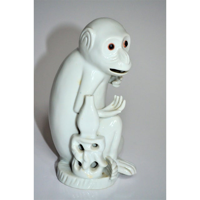 This is a quizzical and charming Mottahedeh Imports collectible white porcelain monkey. He is handcrafted in a glazed...
