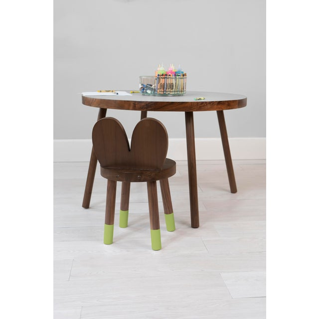 Lola Walnut Wood Kids Chair. Lola mixes classic simple design with an animal inspired twist from ears to white tipped...