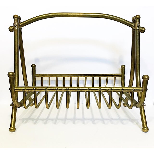 Although the intended purpose is to hold magazines, this vintage brass piece could hold and organize a mulitude of items....