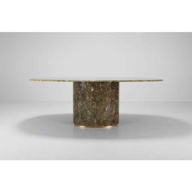 Marble and brass dining table in true Regency style by Jean Charles. The onyx and gold leaf combination make this table a...