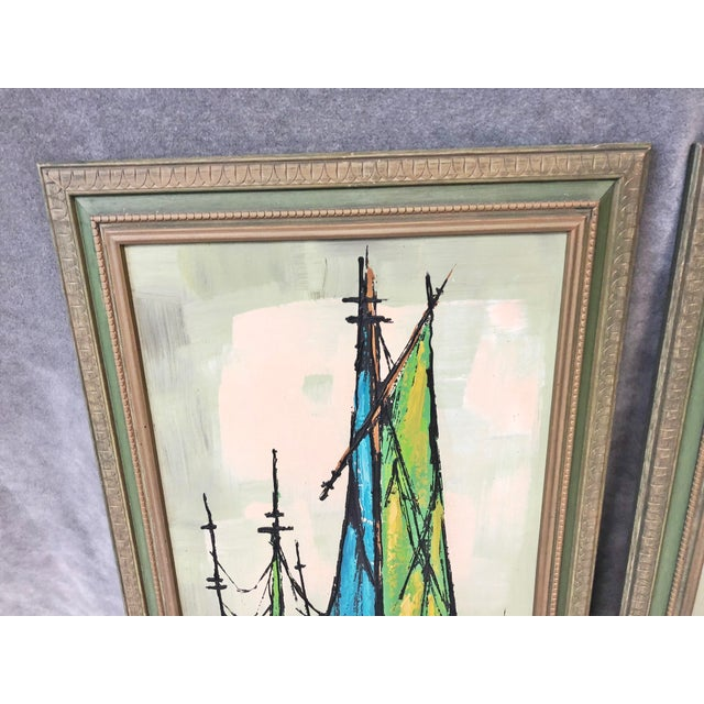 Vintage 1960s Framed Prints. Features an abstract of green sailboats. Carved wood frame. Print is high quality giclee with...