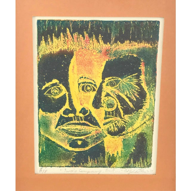 """Framed 1974 relief print depicting colorful abstract faces by Ed Goldstein. The roughly 6"""" x 8"""" print is marked as an..."""
