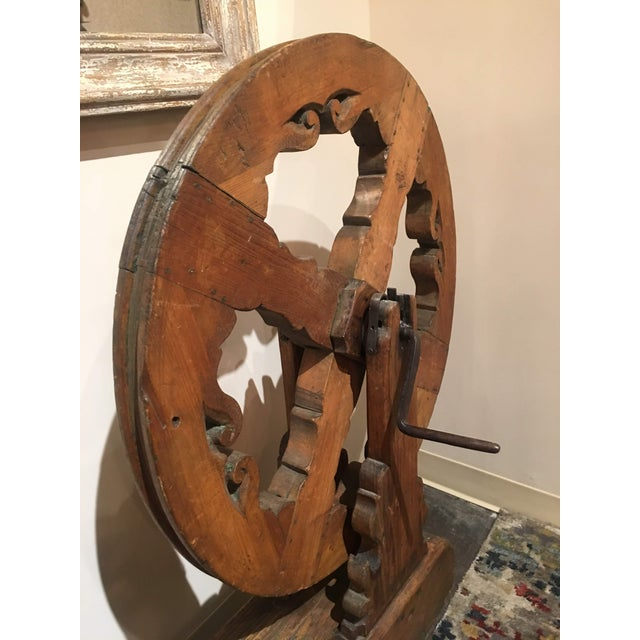 This Antique Spinning Wheel was purchase in France during one of the store buying trips. Its a fabulous piece of history...