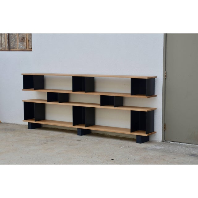 A low 'Horizontal' matte black and polished oak shelving unit by design Frères. In the four shelves version. Anthracite...