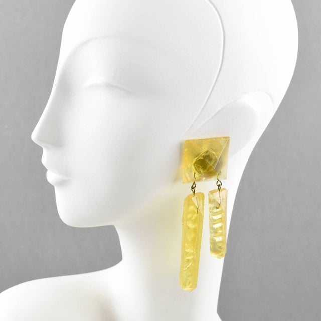 Stunning oversized carved Lucite clip on earrings. Dimensional dangling shape with raw textured carved ice rock in...