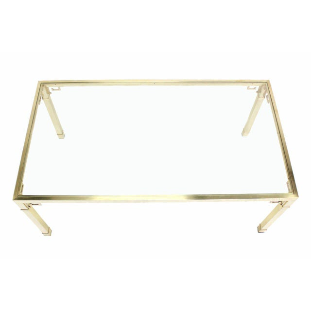 Solid brass tubing frame glass-top dining table by Mastercraft.