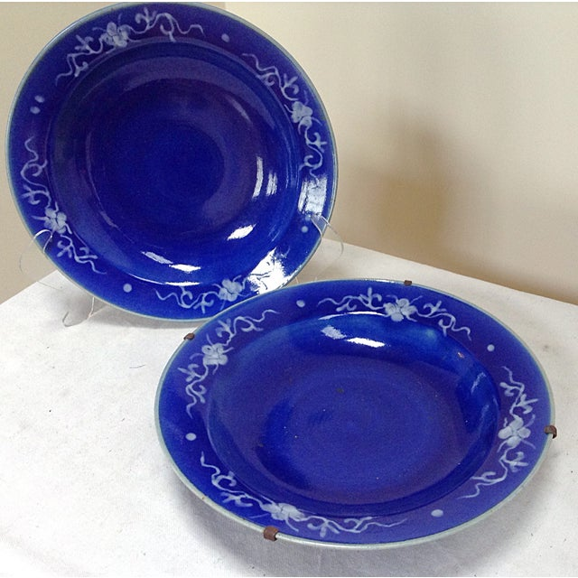 Nice Pair of Chinese blue ground bowls with white enamel. One has a custom metal hanger on it the other one no longer...