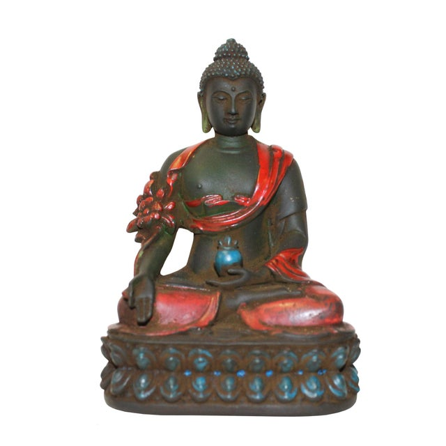 This is a nicely made crystal glass small statue of oriental Chinese Buddha . He is holding a lotus bowl and a lotus...