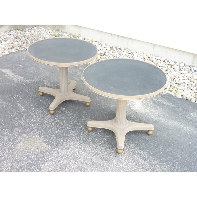 Pair of painted low round tables, use side by side as a coffee table or as low end tables, reeded pedestal base with brass...