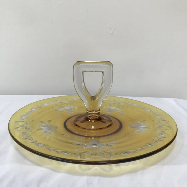 Vintage depression glass tidbit serving tray with the most incredible color yellow flashing. The flashing is enhanced by...