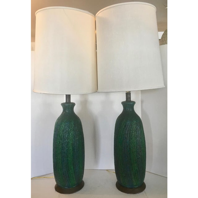 This is a vintage pair of volcanic finish glaze lamps signed Quartite Creative Corp MCMLXV. The colors are deep and bold....