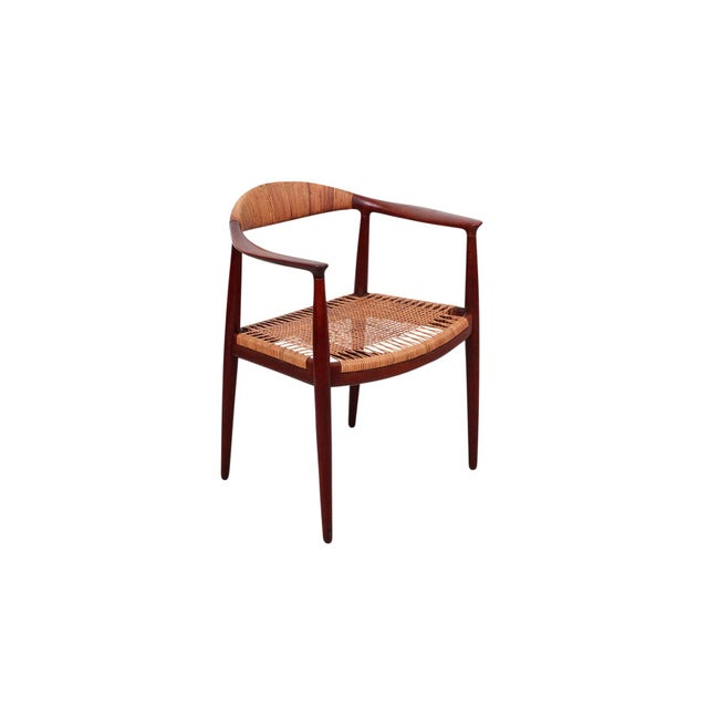 The Classic Chair designed by Hans Wegner for Johannes Hansen with caned seat and back rail. Branded to underside support....