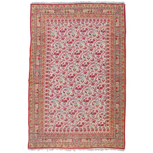 Woven in the central Persian city of Yazd, this elegant rug draws sinuous flowering vine-scroll emanating horizontally...