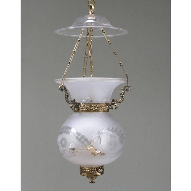 An early 19th century English Regency frosted glass bell jar lantern with brass, circa 1830, featuring floral etchings,...