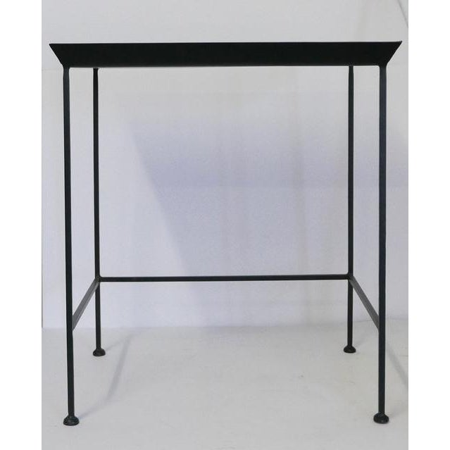 Black metal tray table. Trays used to go on table bases for easy serving. This could be used as a combo. close to the...