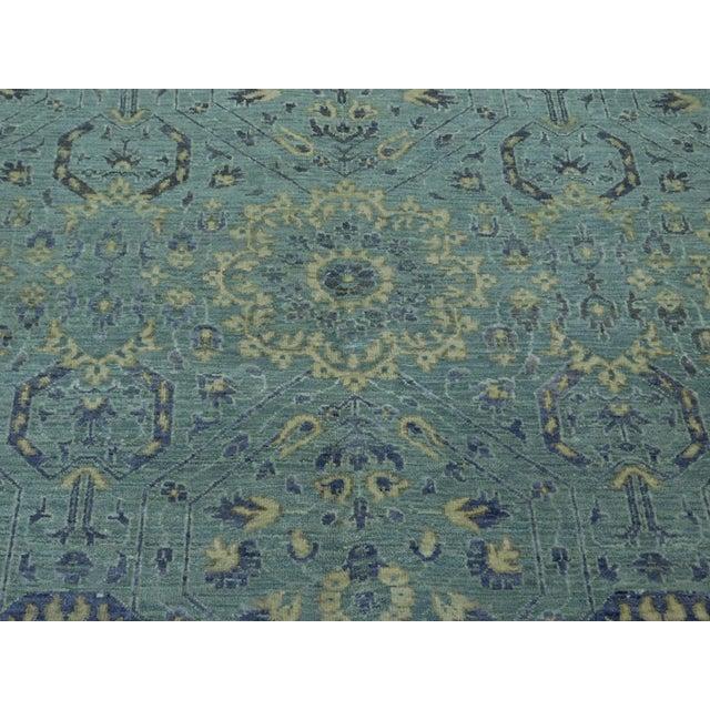 "Origin: India Size: 8'2"" round Design: Farahan Material: Wool Primary Color: Sky Blue Secondary Color: Ice Description:..."