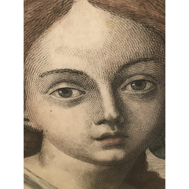 A beautiful early hand colored engraving of an ethereal female face adorned in head wreath.