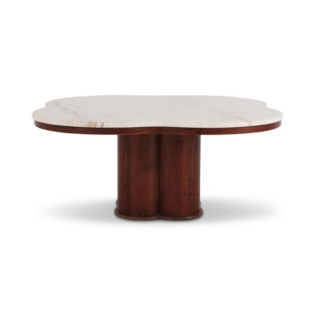 Mid-century modern, late art deco style coffee table with travertine top and walnut base the clover shaped top and base...