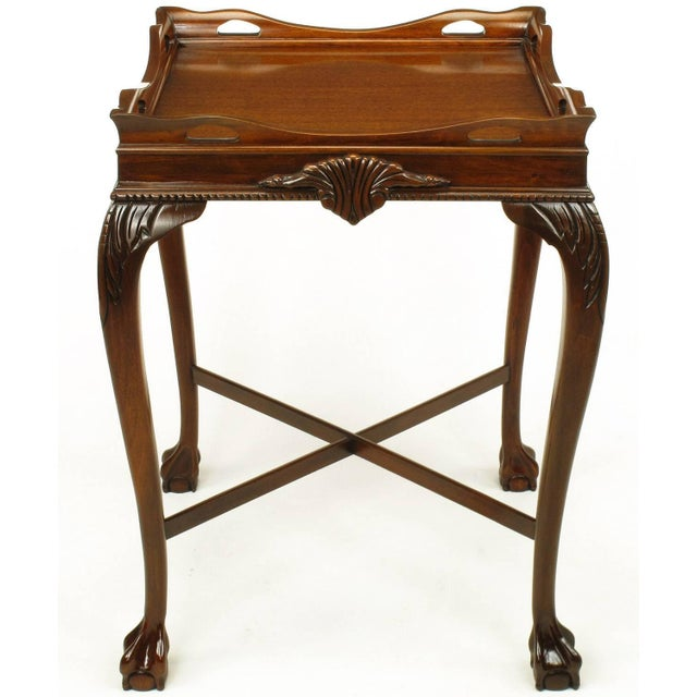 Expertly carved mahogany ball and claw footed tables in the style of George ll. Cabriole legs, pierced mahogany gallery,...