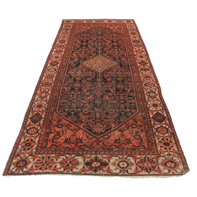Crafted of hand-knotted wool, this Persian Malayer runner is ideal for a chic, traditional space.