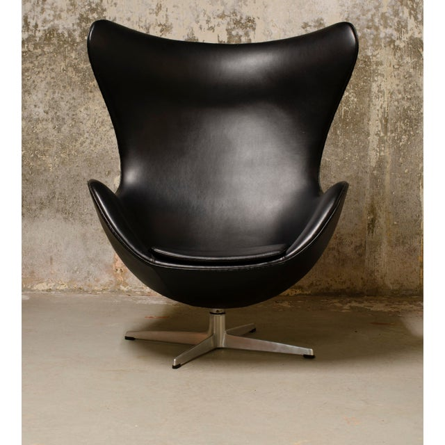 The iconic egg chair, model 3316 and matching footstool model 3127, designed by Arne Jacobsen. Produced by Fritz Hansen in...