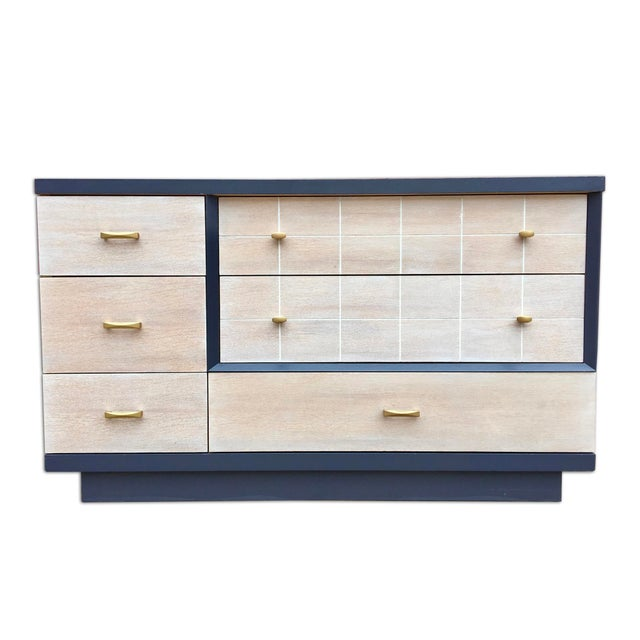 "A mid-century bedroom set with a contemporary feel. The set includes a long dresser (54.5""w x32""h x18""d), a tall dresser..."
