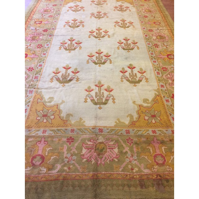 Antique Turkish Oushak rug. Contact dealer.