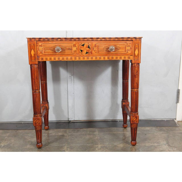This incredibly rare piece of American Folk Art furniture is inlaid throughout with hand-cut geometric patterns using...
