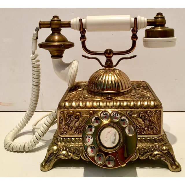 Vintage Illinois Bell Telephone French style cameo rotary repousse telephone. Features a gilt repousse Art Nouveau style...