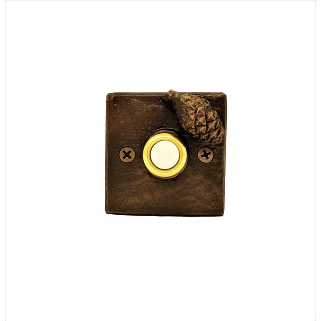 This particular doorbell is highlighted with with a small closed ponderosa pine cone. 5 TO 6 WEEK LEAD TIME IF NOT IN...