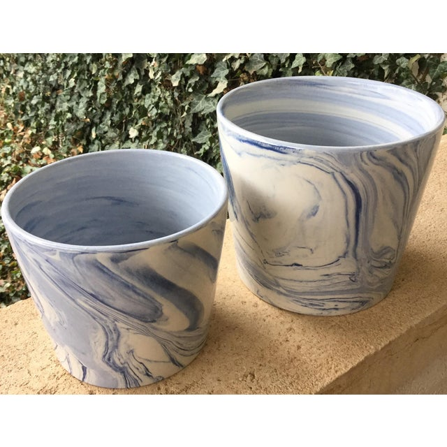 """This pretty set of blue and white marbleized plant pots are in excellent condition. The tall pot is 7"""" tall and 8"""" in..."""