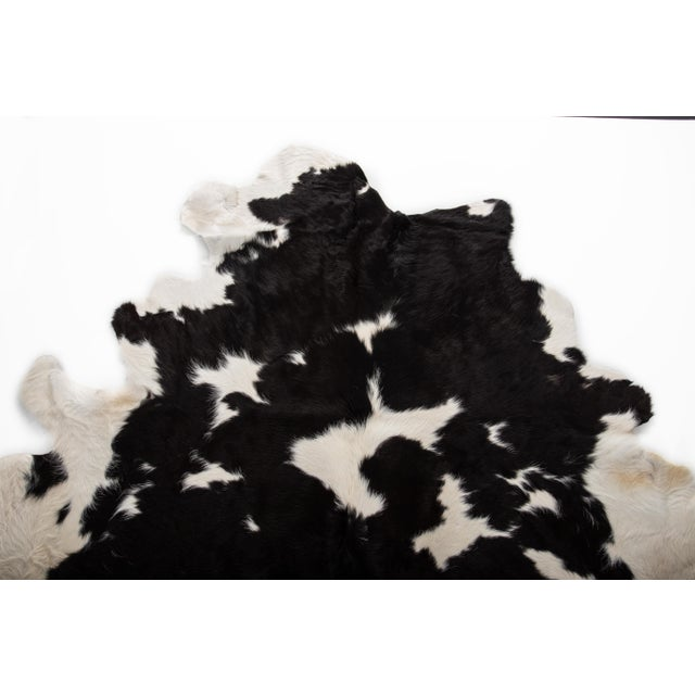 Handmade Black & White Cowhide Area Rug - 6′ × 7′ For Sale - Image 4 of 8