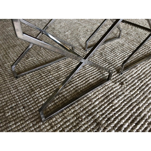 Two chrome X framed side tables with smoke / tinted glass tops. The tables are in excellent condition. Perfect as a side...
