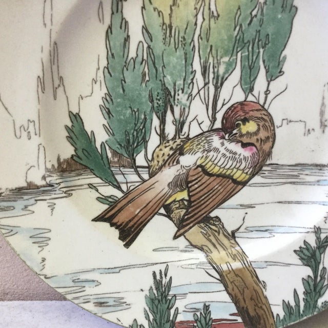 English blue bird plate in a landscape signed Mintons (mark 1873 to 1912).