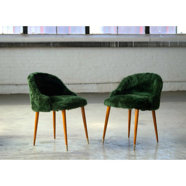 Very elegant and charming pair of vanity chairs, Frode Holm inspired. Elm wood legs with brass shoes on the front and...