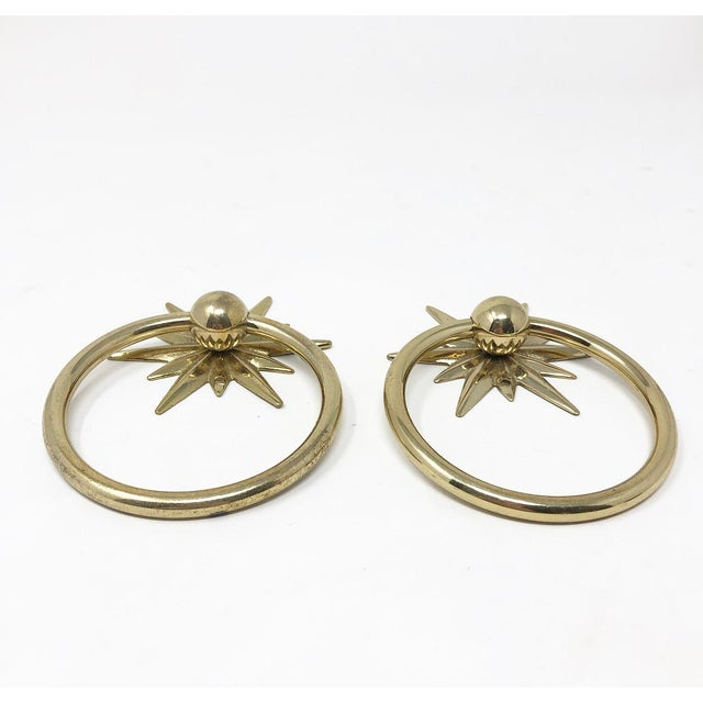 1960s mid-century starburst design ring hardware pulls. Each pull has a top and bottom nail hole to attach to the piece...