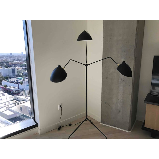 Chic and adjustable black 3 light floor lamp. Great for a Living Room, Bedroom, or Office.