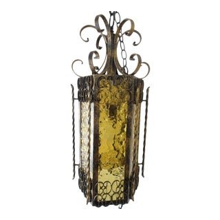 Vintage Mid-Century Wrought Iron & Amber Stained Glass Swag Lamp For Sale