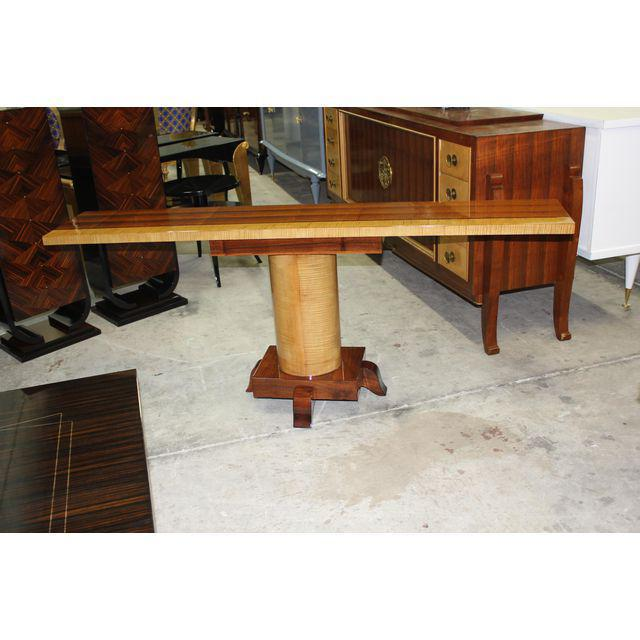 Spectacular long pair of French Art Deco Palisander with sycamore console tables, circa 1940s. Constructed of beautiful...