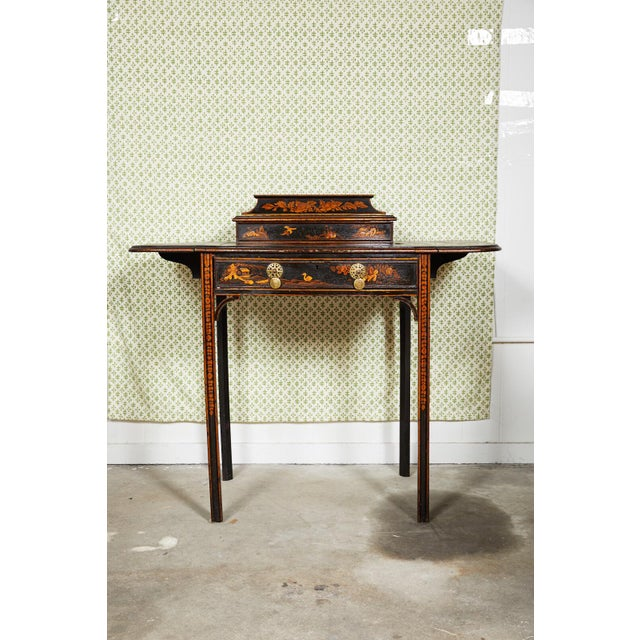 Charming 19th century English Regency style bow front writing table or desk in black lacquer with raised painted...